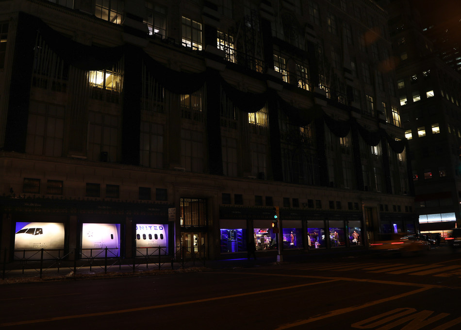 "United Polaris business class takes over the windows at Saks Fifth Avenue in New York City. Entitled ""Now Arriving,"" the 14 storefront windows display a replica of a United Airlines plane. The center six windows feature a re-creation of the United Polaris business class experience, including actual United Polaris seats, which will debut on flights in February, and the cabin's custom Saks Fifth Avenue bedding suite."