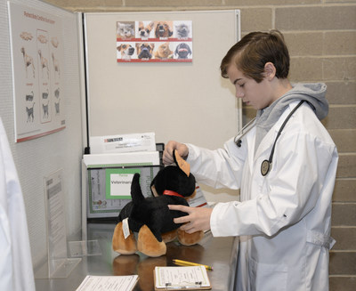 A student from Ste. Genevieve du Bois school in St. Louis plays the role of veterinarian in Nestle Purina's new storefront at JA BizTown in Chesterfield, Missouri.