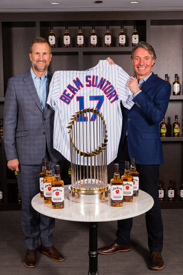 Chicago Cubs President of Business Operations, Crane Kenney, and Beam Suntory CEO, Matt Shattock, pose behind Major League Baseball's Commissioner's Trophy.