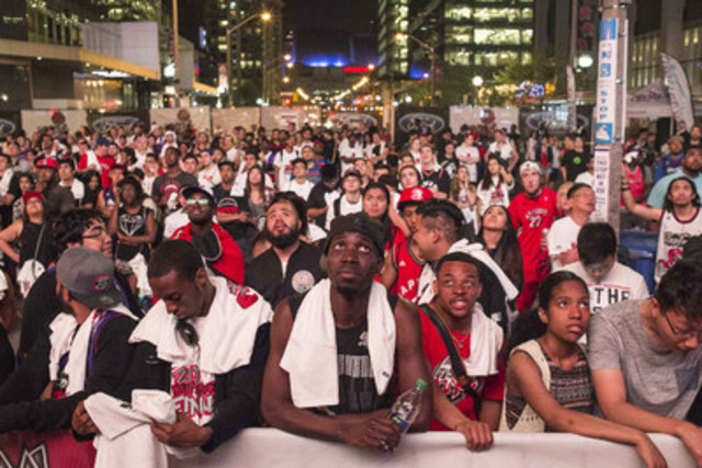 As part of his award experience, Eduardo Lima, the 2016 Tom Hanson Photojournalism Award winner, captured this photo of Toronto Raptors' fans watching the the big screen outside the Air Canada Centre during game five Eastern Conference final NBA playoff basketball action against the Cleveland Cavaliers in Toronto May 25, 2016. THE CANADIAN PRESS/Eduardo Lima (CNW Group/Canadian Journalism Foundation)