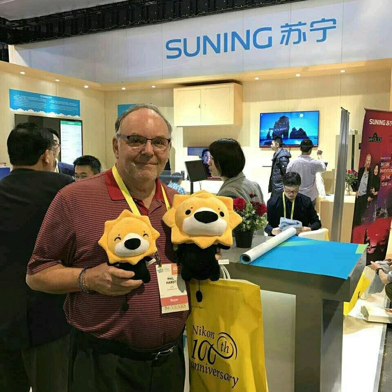 "A visitor is taking photo with Suning mascot ""Suning Lion"" at the CES"