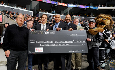LA Kings present Ronald McDonald House Inland Empire with a check for $1 million (L-R) Mike Kovack, Ronald McDonald House of Loma Linda Executive Director; Kelly Cheeseman, COO AEG Sports; Luc Robitaille, President of Business Operations LA Kings; Joey Ferrell, Current Board President; Vince Bryson, CEO at Ronald McDonald House Charities of Southern CA; Jay Brand, Board Chair Past President; Clay Pachen, McDonald's Operator Association of Southern California; and Bailey, LA Kings Mascot.