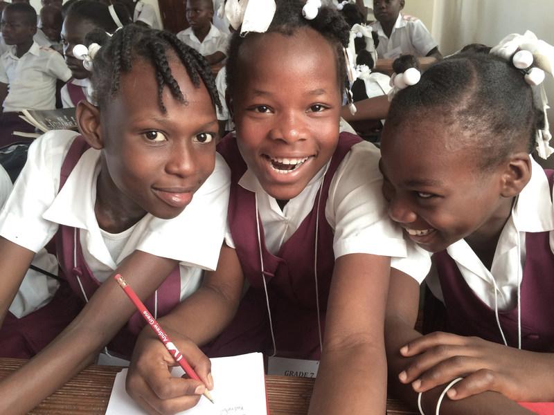 Smiling children of the Andrew Grene High School in Haiti