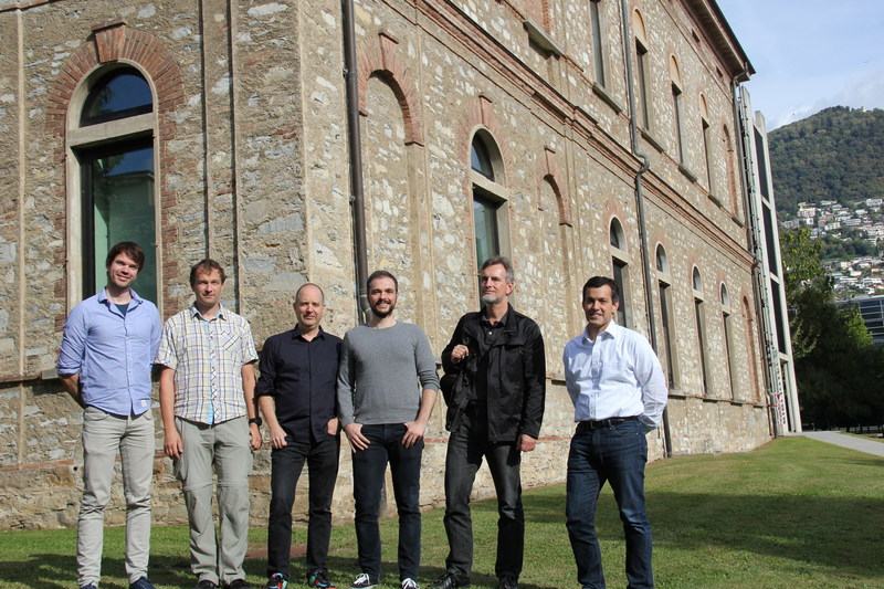 Photo caption, left to right: Nnaisense Co-Founders Bas Steunebrink, Jan Koutnik, Faustino Gomez (CEO), Jonathan Masci, and Jurgen Schmidhuber (president) with Alma Mundi Ventures Founding Partner Rajeev Singh-Molares outside of the University of Lugano library, Lugano, Switzerland. The startup's new investment from Singh-Molares' firm will be used to hire engineers and researchers to satisfy the growing need for Nnaisense's technology in industries such as manufacturing and financial services.