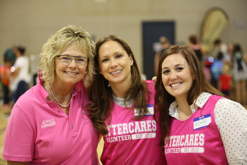 Otter Products employees receive 24 hours of volunteer time off per year to go out into the community to make a difference. From left, OtterCares Founder Nancy Richardson, Sandy Utley and Hillary White help make a difference at Pack2School.