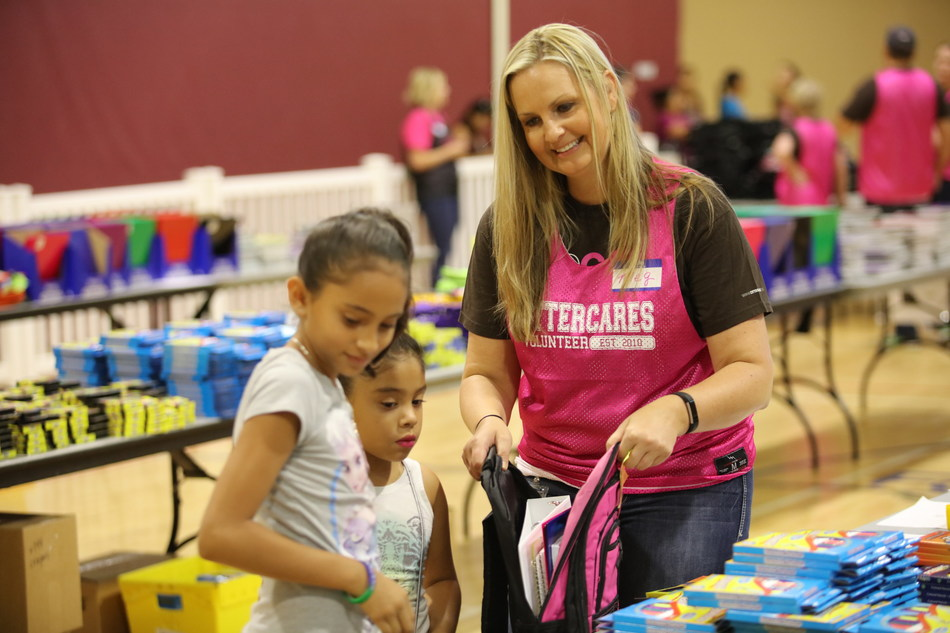 Otter Products employee, Megan Jacobson, helps stuff backpacks at Pack2School, a hometown event that provides backpacks and supplies, along with activities that teach philanthropy and entrepreneurship to thousands of students at the start of every school year in Northern Colorado.