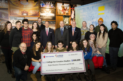 Students and faculty from College for Creative Studies receive a check from Olympia Development of Michigan and Ilitch Charities for a new public art program in Detroit.