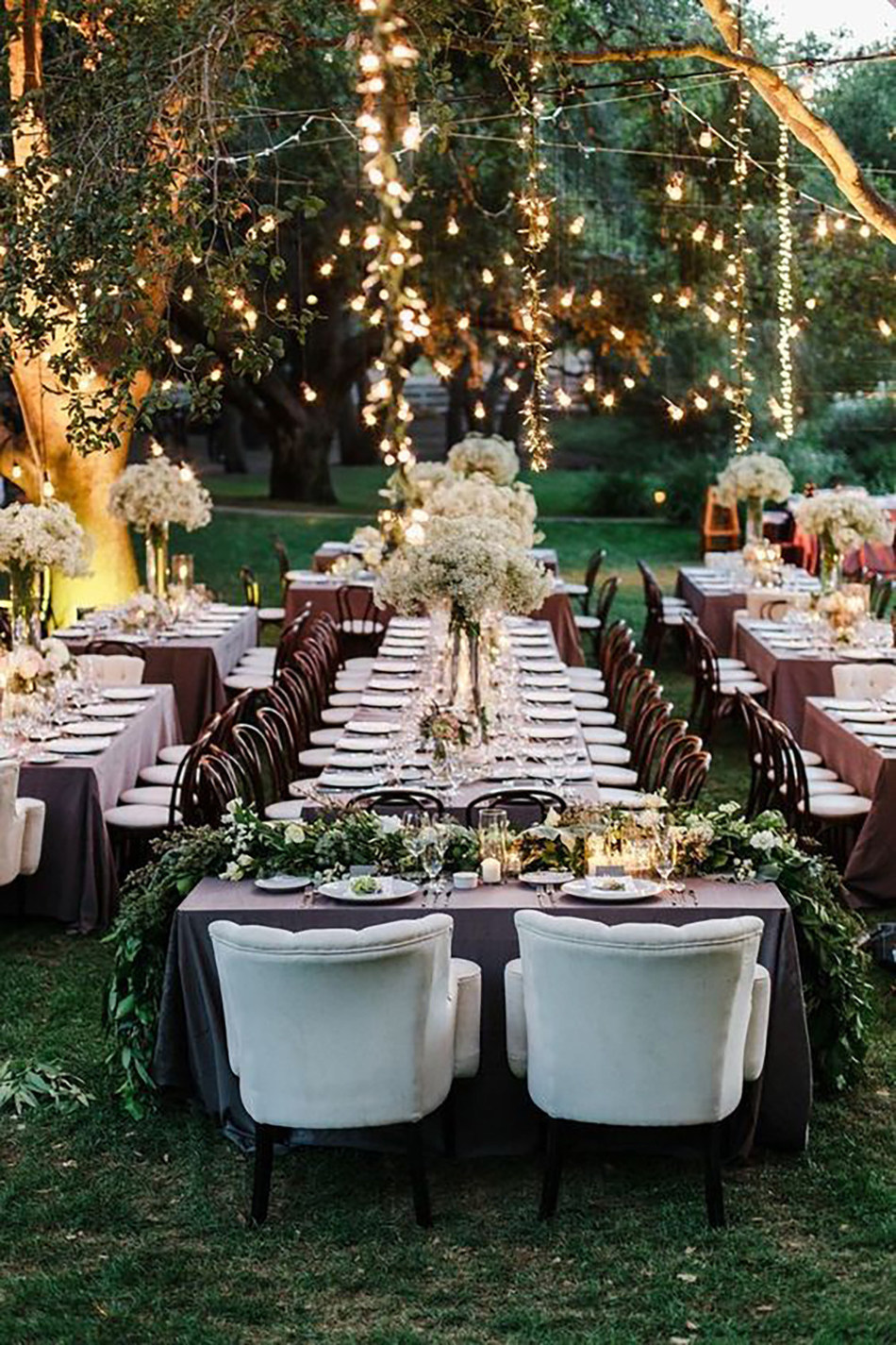 Inspired by the Pantone Color of the Year, Greenery, which symbolizes a reconnection with nature, one another and a larger purpose, we're seeing a rise in decor going au naturel and couples giving back with their weddings in more ways than one. Photo courtesy of Steve Steinhardt Photography and The Knot.