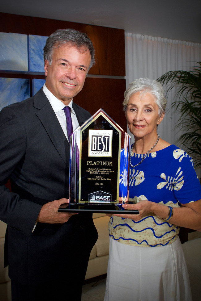 Beatriz Baldan & George DeArmas accept the Platinum Award for The Sanctuary at Cutler Bay Project by 3Ci, Inc
