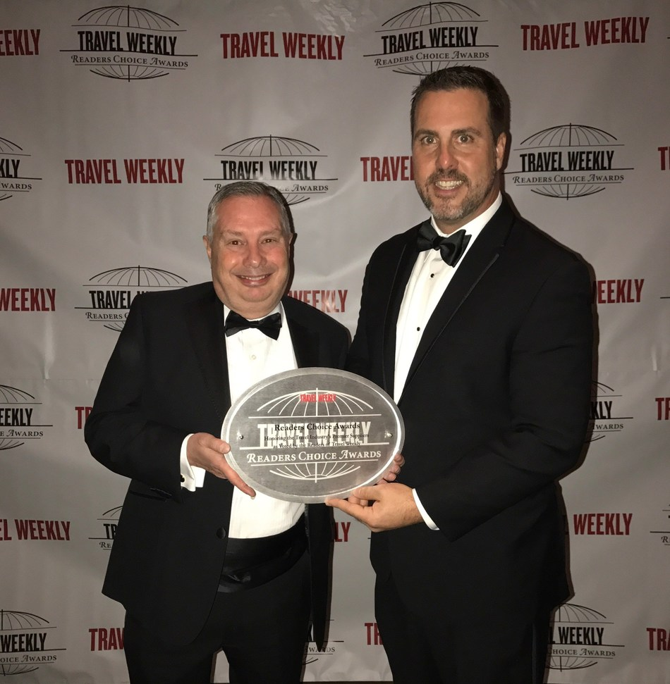 Enterprise Holdings' Tony Consenza and Jay Pope accept Travel Weekly's Readers Choice Award.