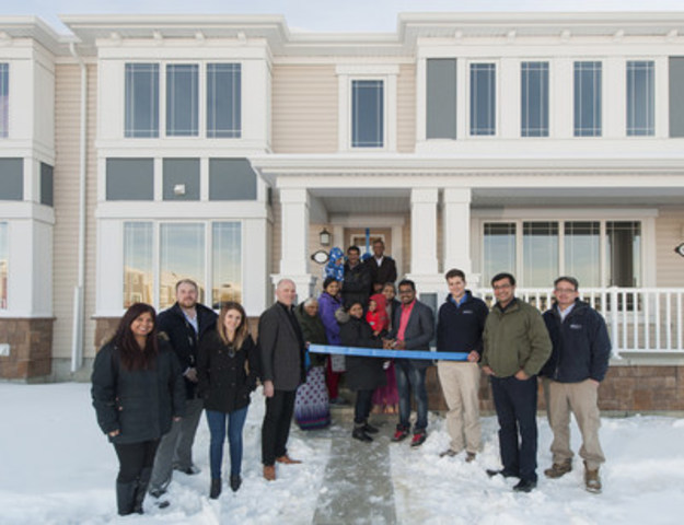 Members of the Mattamy team recently welcomed the 2,500th homeowner in the Calgary Region. From left to right: Christine Turner, Director, Customer Care & Design Studio; Stefen Vavrek, Sales Consultant; Heather Bears, Lead Customer Care Coordinator; Warren Saunders, Vice President, Sales & Marketing; Blessy Cherian, Homeowner; Sam Mathew, Homeowner; Ryan Prefontaine, Builder; Matt Tredinnick, Assistant Builder (CNW Group/Mattamy Homes Limited)