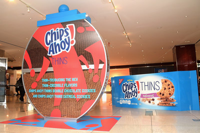 On Wednesday, Jan. 18, Chips Ahoy! THINS cookies unveiled a larger-than-life cookie jar, with a super thin twist at the Time Warner Center in New York City for one day only. The jar showcases two new flavor additions - Double Chocolate and Oatmeal - and gives fans the opportunity to guess how many cookies are in the jar for a chance to win a year's supply of Chips Ahoy! THINS. Photo Courtesy of Getty Images.