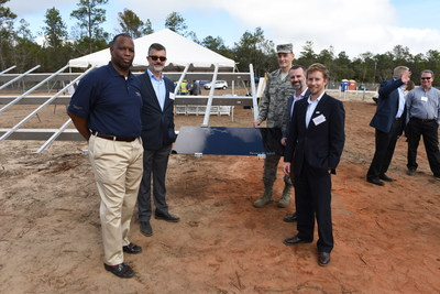 Coronal Energy and Gulf Power Ceremonial Panel Event at Eglin Air Force Base. On the left (from back to front) Ed Feo, President, Coronal Energy, Michael Burroughs, Vice President - Senior Production Officer, Gulf Power Company. On the right (from back to front) Col. Johnson, Eglin Air Force Base, Pete Bronski, Marketing & Content Strategy, Panasonic Enterprise Solutions Company, Danny Van Clief, Chief Commercial Officer, Coronal Energy