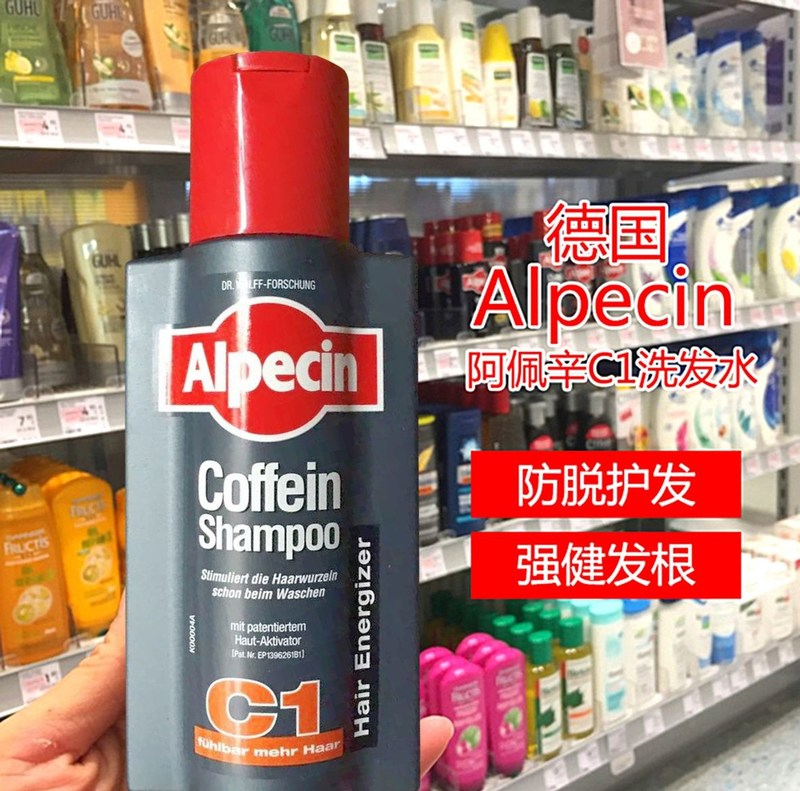 Alpecin caffeine shampoo in front of a German drugstore shelf with Chinese translation (PRNewsFoto/Dr. Wolfe-Gruppe)