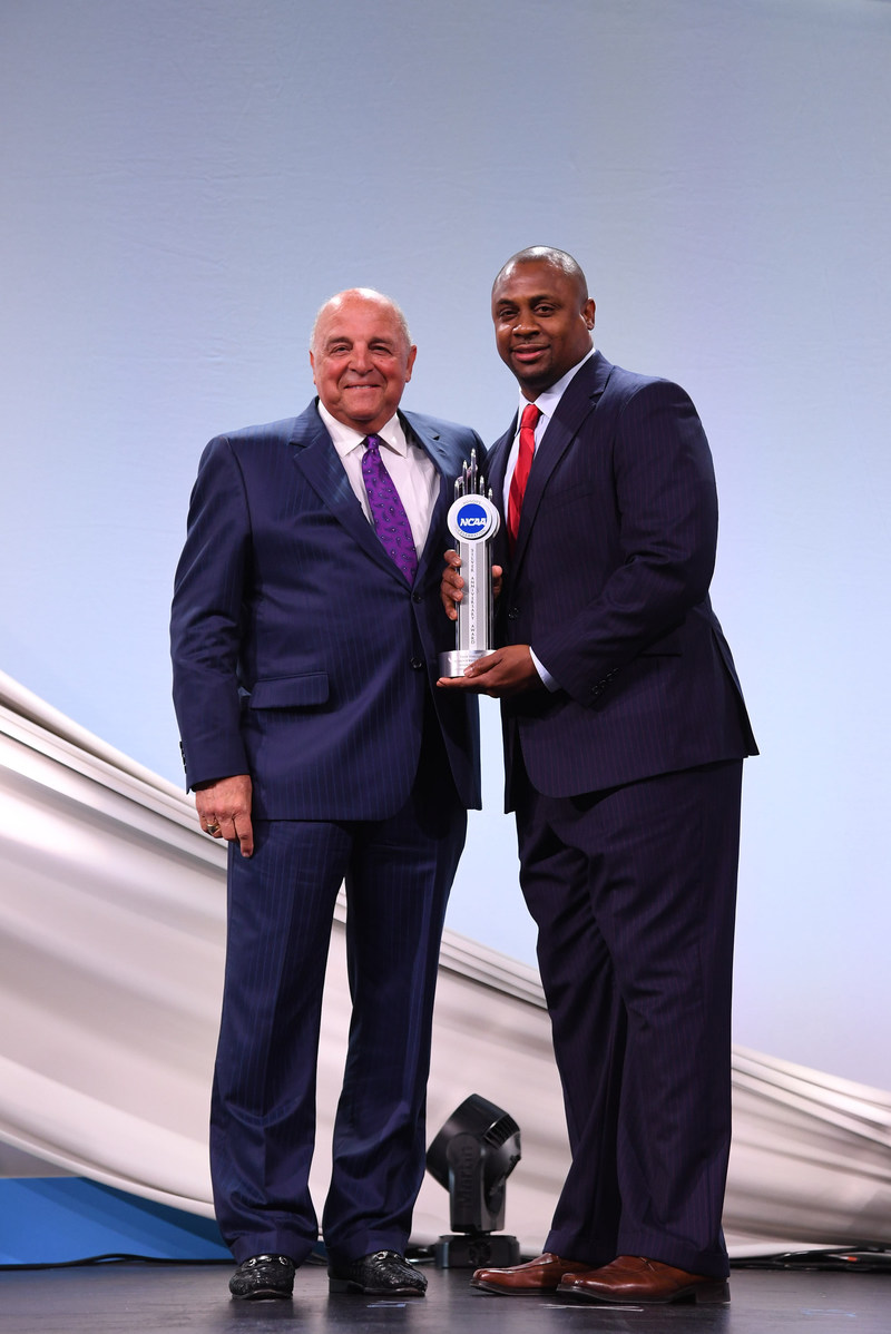 Troy Vincent (right), NFL Executive Vice President of Football Operations and former University of Wisconsin-Madison and NFL player receives the 2017 NCAA Silver Anniversary Award for his collegiate and professional achievements including his significant dedication to community service. Pictured with University of Wisconsin-Madison Athletics Director and College Football Hall of Famer coach Barry Alvarez (left).