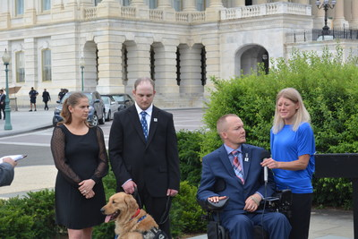 Christy and Jeff Lynch (with service dog Woody) join Matt and Tracy Keil during a June 2016 news conference about the need for fertility assistance for some wounded veterans.