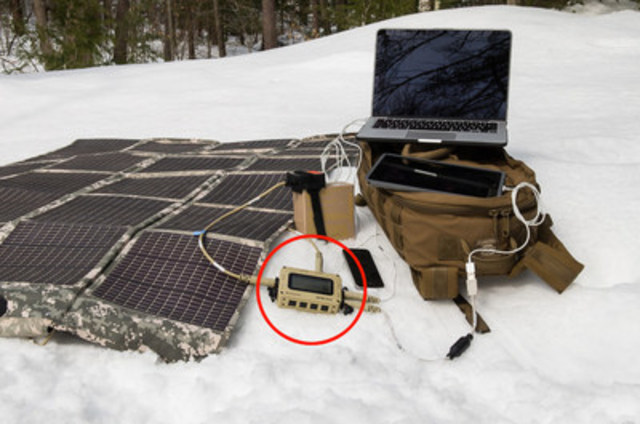 SPM-622 (circled in red) shown powering a laptop, tablet, iPhone & military battery, all from a solar blanket (CNW Group/Ballard Power Systems Inc.)