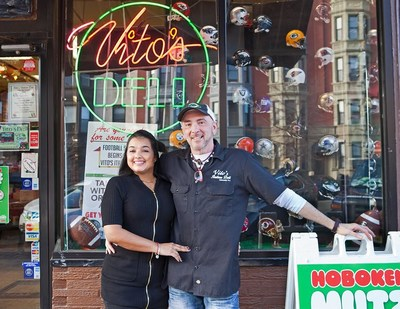 Vito Buzzerio and his wife Celeste in front of Vito's Italian Deli.