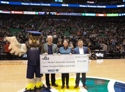 Pictured left to right: WGU's mascot, Sage; WGU's Chief Marketing Officer, Patrick Partridge; and WGU's Scholarship Manager, Amanda Savage, receive the Utah Jazz's $12,000 scholarship contribution from Jazz President, Steve Starks.