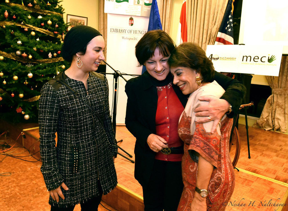 (L-R) Lena Alfi, director of partnerships, Middle East Children's Institute (MECI) smiles as H.E Reka Szemerkenyi, Ambassador of Hungary hugs Shahin Mafi, Founder & Trustee  of the Azar Foundation for Children of the World (C)Photo credit by Neshan H. Naltchayan (PRNewsFoto/Azar Foundation for Children ...)