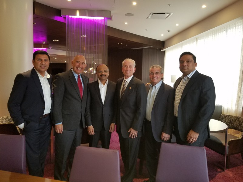 Executives from G6 Hospitality and Auromatrix Holdings at the signing of the area development agreement in India.