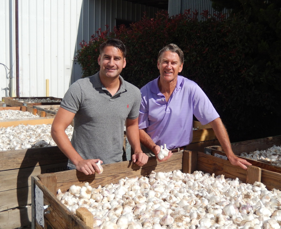 Ken Christopher (left) and Bill Christopher (right) with premium Christopher Ranch garlic.