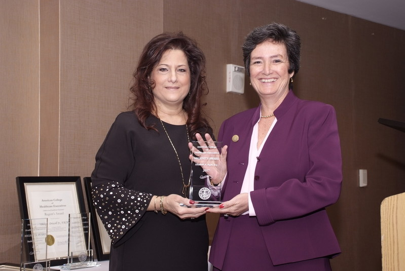 ACHENJ Regent Nancy DiLiegro, FACHE, chief clinical officer at Trinitas Regional Medical Center, presents Betsy Ryan, president and CEO of NJHA, with the Lifetime Achievement Award.