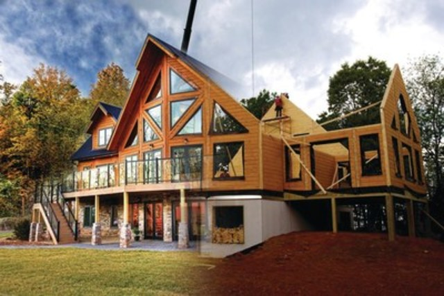 One day Wall Raising using Timber Block's patented panelized insulation wall system. (CNW Group/Timber Block)