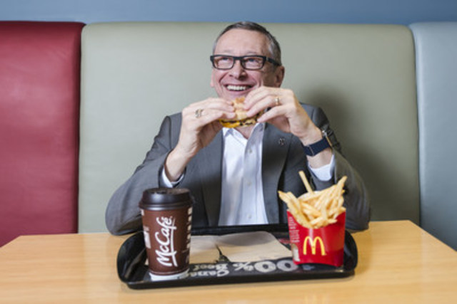 John Betts, McDonald's Canada, President and CEO enjoys an Egg McMuffin after 11 am. On February 21, 2017, All Day Breakfast Selections will be available for guests across the country. (CNW Group/McDonald's Canada)