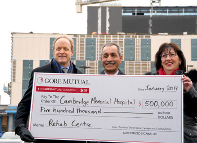 Patrick Gaskin, President & CEO, Cambridge Memorial, Farouk Ahamed, Chair of the Board, Gore Mutual and Heidi Sevcik, President & CEO, Gore Mutual, in front of the under-construction wing that includes the new Rehab Centre. (CNW Group/Gore Mutual Insurance Company)