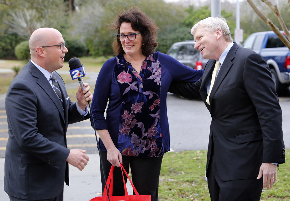 Kirk Saville, svp, corporate communications at BJ's Wholesale Club (right) surprises Robin Smith, teacher at Edmund A Burns Elementary School (center) with meteorologist Josh Marthers live on-air during WCBD-TV's News 2 at Midday on Thursday, Jan. 26, 2017, in Mount Pleasant, S.C. with the announcement that BJ's has donated over $100,000 to help fund classroom projects in Summerville, Charleston and the surrounding areas through DonorsChoose.org. (Mic Smith/AP Images for BJ's Wholesale Club)