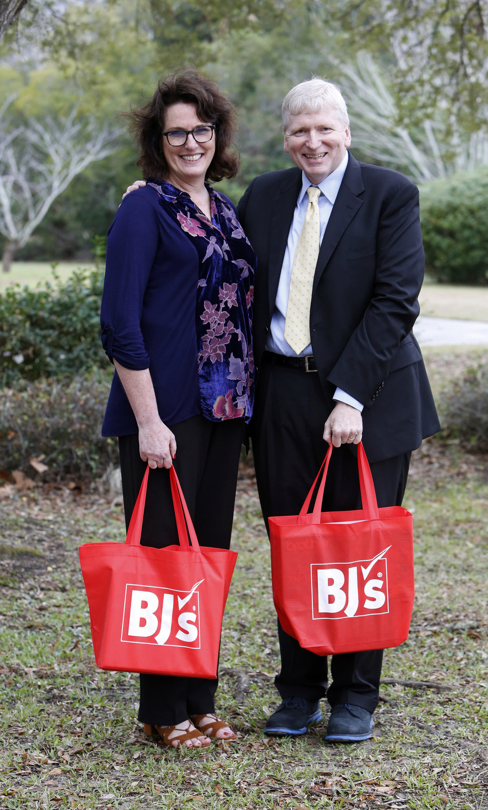 Kirk Saville, senior vice president, corporate communications at BJ's Wholesale Club (right) presents Robin Smith, teacher at Edmund A Burns Elementary School (left) on Thursday, Jan. 26, 2017, in Mount Pleasant, S.C. with the announcement that BJ's Wholesale Club has donated over $100,000 to help fund classroom projects in Summerville, Charleston and the surrounding areas in South Carolina through DonorsChoose.org. (Mic Smith/AP Images for BJ's Wholesale Club)