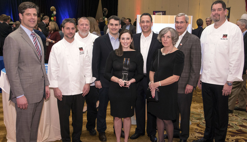 At the reception (left to right): IFDA's Mark Allen, Major Products' Chef Chris Enright, Chef Jim Villemaire, Dan DeRose, Valerie Derose Leimer, Scott Smolar, Susan DeRose, Dot Foods John Tracy (IFDA Vice Chairman), and Major Products' Chef James Bell.