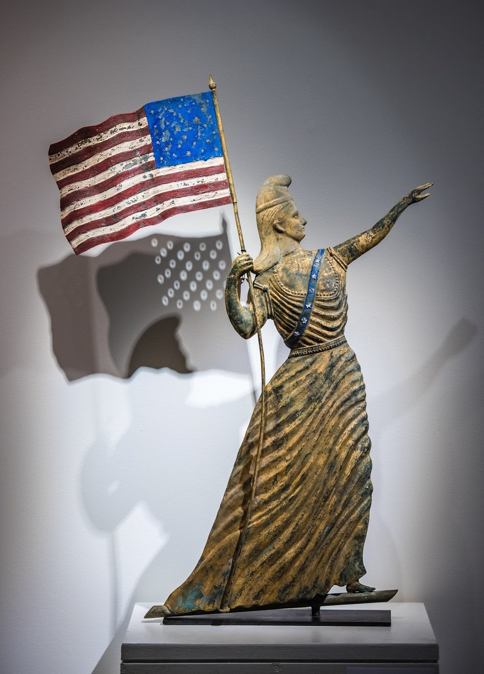 An Important Gilt and Painted Molded Copper Goddess of Liberty with Flag Weathervane, Possibly by J.L. Mott Ironworks, New York, circa 1880