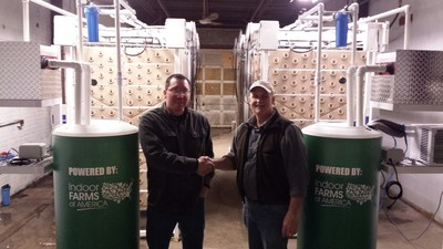 Dave Martin congratulates Jay John in the Salamanca New York Indoor Farm