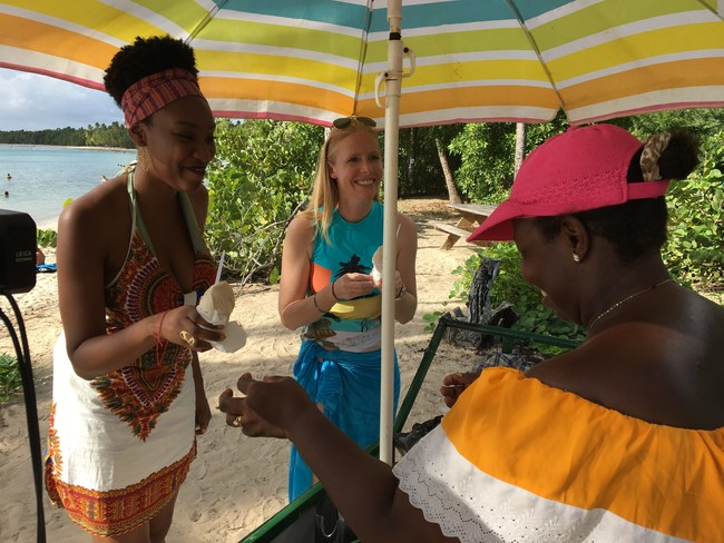 """Enjoying coconut sorbet at Les Salines, one of Martinique's beautiful beaches, while filming for """"Travels with Darley""""."""