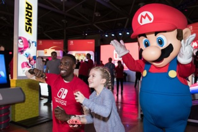 Lilah Rosevear, 8, gets a first look at Nintendo's newest gaming system at the Nintendo Switch Preview Tour in Toronto. A home video game system that instantly transforms into an on-the-go handheld, Nintendo Switch launches nationally on March 3, 2017. (CNW Group/Nintendo of Canada Ltd.)