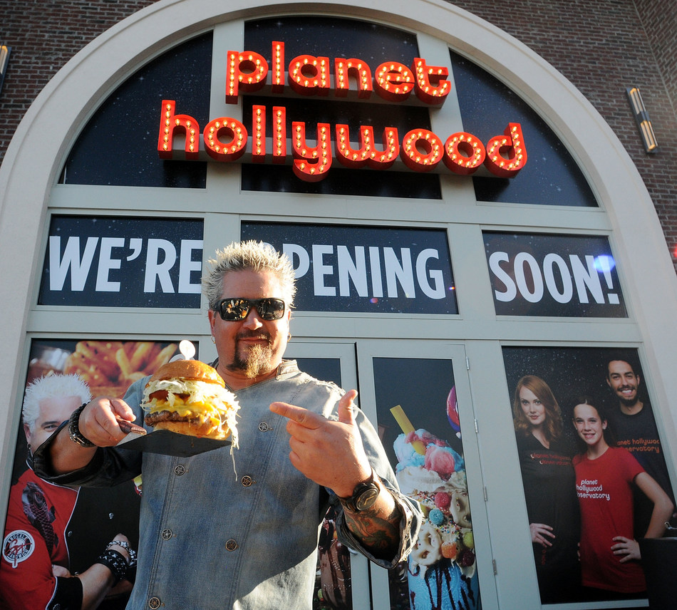 Celebrity Chef Guy Fieri Signs Off On His New Out Of This World Burger And Sandwich Menu At Planet Hollywood Observatory In Disney Springs on January 19, 2017 in Orlando, Florida.  (Photo by Gerardo Mora/Getty Images for Planet Hollywood Observatory)