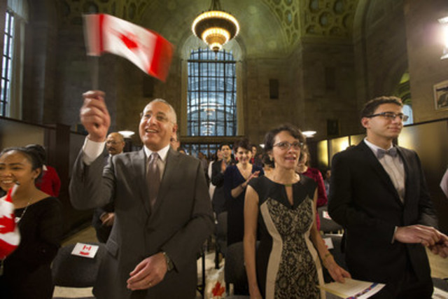 CIBC and IRCC welcome 21 new Canadians at a Citizenship Ceremony held in CIBC's historic banking hall. (CNW Group/CIBC)