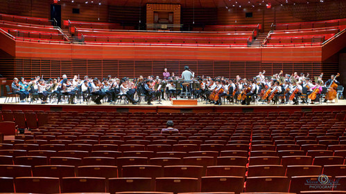 Philadelphia Music Alliance for Youth (PMAY) orchestra students rehearse onstage with Lio Kuokman, Assistant Conductor of The Philadelphia Orchestra, in the Kimmel Center's Verizon Hall during PMAY's 2015 Festival.