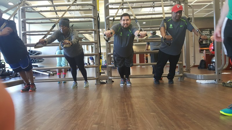 Warriors challenge themselves on TRX straps during a recent Wounded Warrior Project physical health and wellness event.