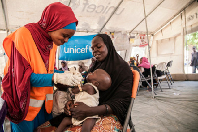 On November 17, 2016, UNICEF Nutrition Officer Aishat Abdullahi assesses seven month-old Umara Bukar for malnutrition at a UNICEF-supported health clinic at Muna Garage IDP camp in northeast Nigeria as Umara's mother looks on. Umara weighed just 4.2kg when he first arrived at the clinic. Twenty days later, he weighed 5.1kg. To date, over 117,000 children with severe acute malnutrition (SAM) in northeast Nigeria have been admitted to therapeutic feeding programs run by UNICEF and partners. But there are still thousands more that need urgent help. © UNICEF/UN041140/Vittozzi (CNW Group/UNICEF Canada)