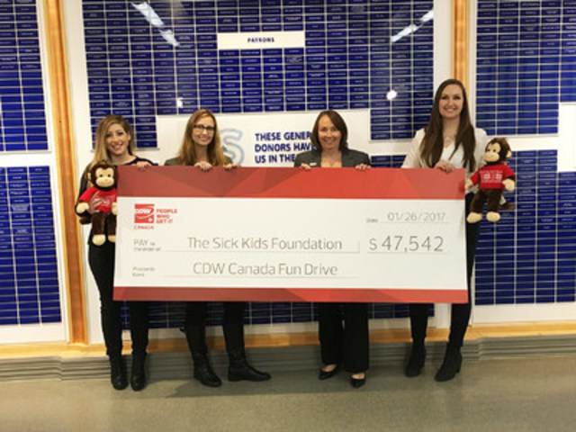 CDW Canada coworkers present a cheque to SickKids. From left to right: Jackie Macera (CDW Canada), Julie Clivio (CDW Canada), Jennifer Frew (SickKids Foundation) and Katerina Sentsisena (CDW Canada). (CNW Group/CDW Canada Inc.)