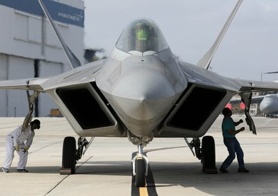 Technicians inspect an F-22 Raptor at the F-22 Speedline in Marietta, Georgia.  Lockheed Martin photo by Andrew McMurtrie.