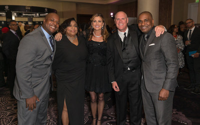 Kathy Ireland, CEO and Chief Designer, kathy ireland(R) Worldwide, with American Family Insurance's Dwayne Maddox, Director of Advertising, Telisa Yancy, Chief Marketing Officer, Jack Salzwedel, Chairman and CEO, and Michael Riggs, Regional Sales Director.