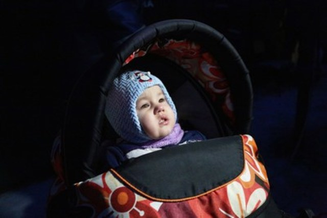 On January 31, two-year-old Leonid visits a heated tent with his family to eat at a mobile kitchen run by emergency services to provide warm food to adults and children affected by the fighting and resulting power outages. Photo: UNICEF/OleksiyFilippov (CNW Group/UNICEF Canada)