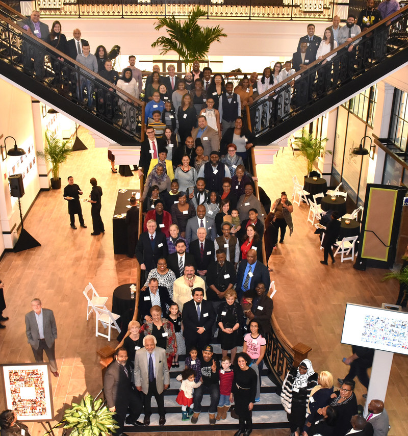 Newark Mayor Ras Baraka, PSEG Chairman Ralph Izzo and Newark 100 People featured in photo that geographically, statistically and ethnically represent the people of Newark.  Photos and stories of Newark 100 People Project displayed at newly remodeled Hahne & Co. building in downtown Newark.  Complete project can also be viewed at 100people.org/Newark.