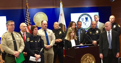 San Diego Chief Deputy District Attorney Summer Stephan and partner agencies speak with reporters at news conference.