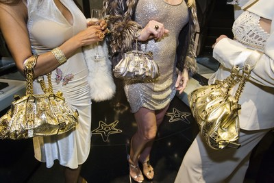 Jackie and friends with Versace handbags at a private opening at the Versace store, Beverly Hills, California, 2007. (C) Lauren Greenfield (image from the Annenberg Space for Photography exhibition, Lauren Greenfield's Generation Wealth)