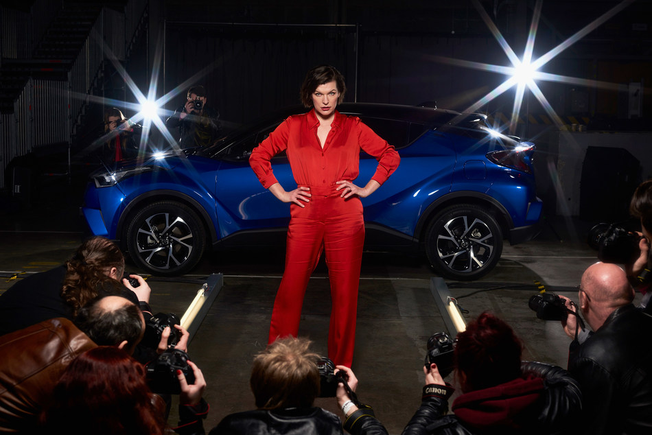 LONDON - 2 FEBRUARY: Milla Jovovich, actress and model, is captured stepping out of the new Toyota C-HR onto a catwalk at the world's first drive through immersive theatre experience. 'The Night that Flows' saw 100 guests experience the immersive event, which brought to life the different features of the new Toyota C-HR. (PRNewsFoto/Toyota)